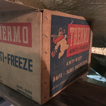Antifreeze cans in box  - Advertising