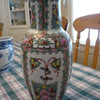 Tall stamped Chinese paneled vase with birds and flowers.