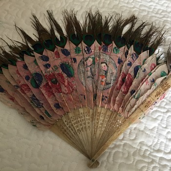 Vintage peacock handheld fan. Does anyone know the era?