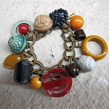 Celluloid and bakelite charm bracelet  - Costume Jewelry