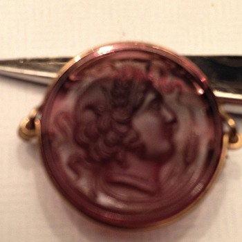 Purple round glass with womans face pin