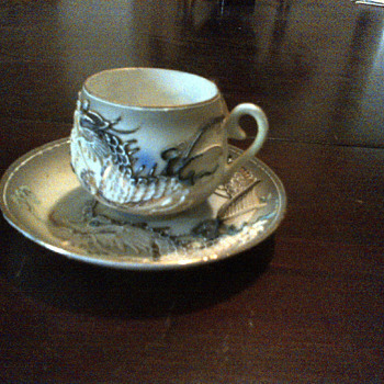 Japanes Tea cup and saucer with hidden Geisha girl in cup