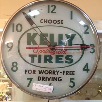 pam lighted Kelly tires clock - Clocks