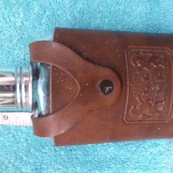 Leather case. with glass bottle. Made in USA liquot holder?? Help