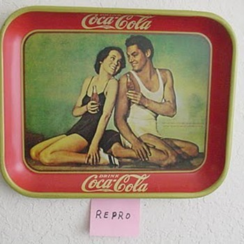 The 1934/1980 Coca-Cola repro Johnny Weismuller/Maureen O'Sullivan serving tray. - Coca-Cola