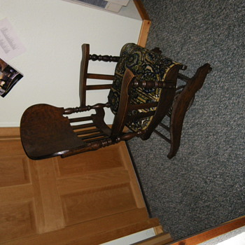 This was my great grandmas chair I believe the tag says chair number 24 anyone know anything about this chair??