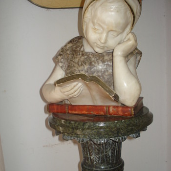 A marble sculpture of a little girl learning to read called Irene - Fine Art