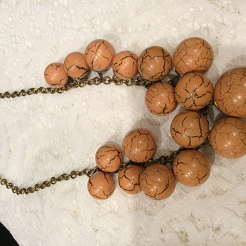 Orange marbleized wood bib style choker with brass chain