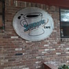 "SATELLITE COFFEE CO. & CAFE' sign, now officially ""wall art"" instead"