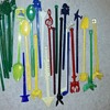 a handful of vintage plastic swizzle sticks
