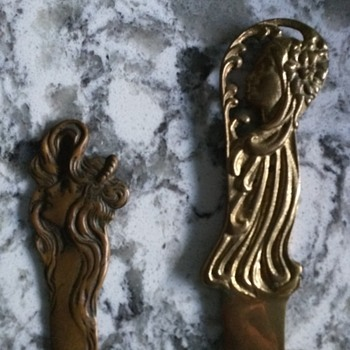 Bronze / copper letter openers woman's heads