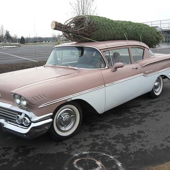 My driver carrying our Christmas tree!  Fun day...  But we love the German cars too! - Classic Cars