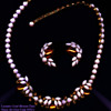 SHERMAN OPAQUE PINK & CHAMPAGNE TOPAZ- TRIPLE LEAF CLUSTER MOTIF NECKLACE SET, SIGNED WITH OVAL CARTOUCHE, EARLY 1950's