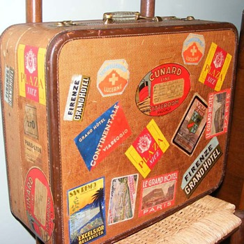 Old suitcase covered in luggage labels from all over Europe - Bags
