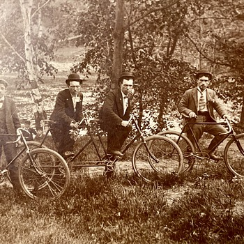 My Great Grand Pepere and his twin on their bicycles and his rustic cabins... - Photographs