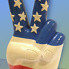 1960s RWB Composition Figural American Flag Hand making the Peace Sign Still Bank