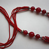 indian necklace, possibly ruby jade (dyed) + coral + garnets