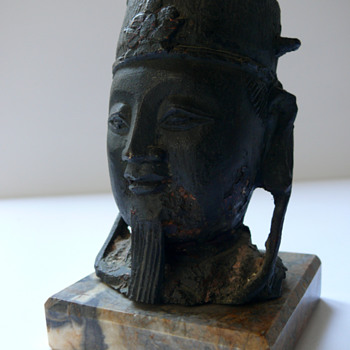 a little older chinese head of a sculpture