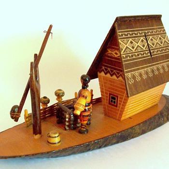 Carved wood bank with cottage scene Ukranian message on label - Folk Art