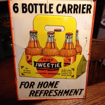 Embossed Sweetie Soda Tin Sign...The Novelty Adv. Co. Coshocton,O. 1940's-1950's