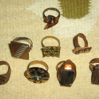 Copper rings w/brass, wood, silver - some adjustable - three w/marks
