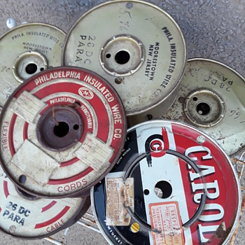 group of old metal wire spools - Electronics