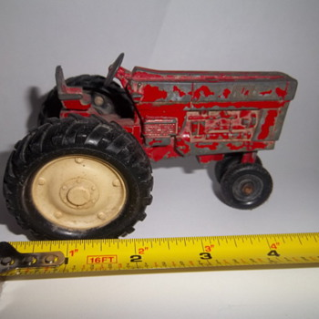 Vintage toy red farm tractor