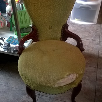 very old chair sits very low and has large springs covered in burlap on bottom - Furniture