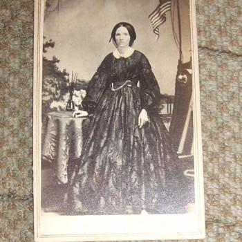 CDV of woman with Civil War backdrop