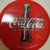"12"" round coca cola button sign. Can anyone tell me anything about it? I was told it's from 1930-1940 pristine condition"