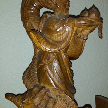 Beautiful carving of a Japanese man with a dragon on his back.