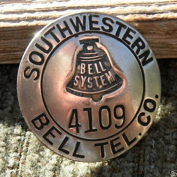 More of the Bell System Employee badges - Telephones