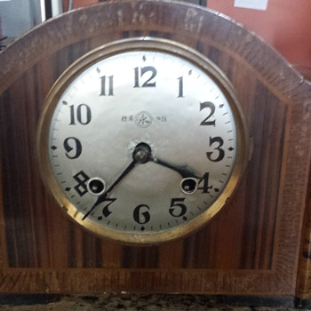 Chinese (?) Deco (?) wood veneer mantel clock with maker's mark inside