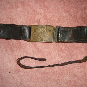 The Civil War Veteran's GAR belt plate with remains of belt. - Military and Wartime
