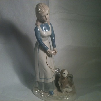 GIRL  WALKING DOG.  - Pottery