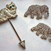 Cat hat pin and 1930s elephants brooches
