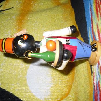 Nodding head wooden doll