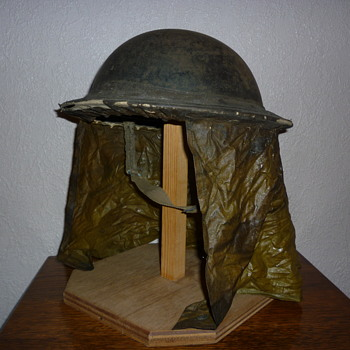 British WWII steel helmet with scarce rain cover