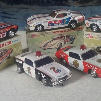 1970s  battery  operated tin cars,mystery action.