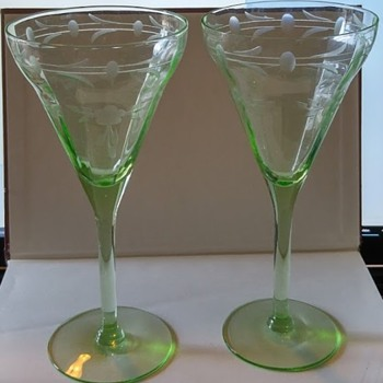 2 wine glasses with cut  flowers - Glassware