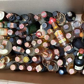 Old liquor bottles sealed with tax stamp - Bottles