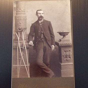 Grand Army of the Republic member with crutches cabinet card - Photographs