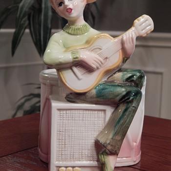 Girl playing guitar planter