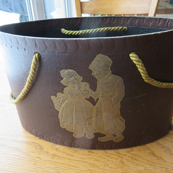 70 year old plus oval cardboard container embossed with Dutch boy and girl