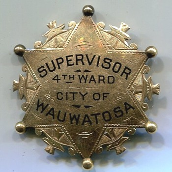 A Very Misleading Wauwatosa Wisconsin Badge - Medals Pins and Badges