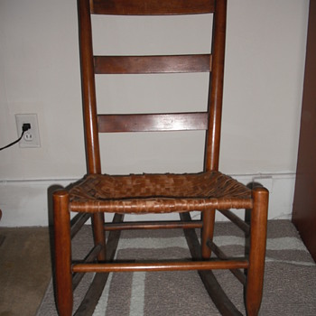 Mid-19th century wood ladder back rocking chair