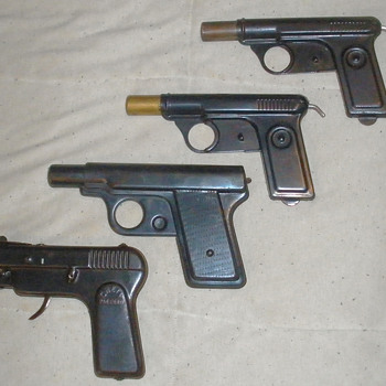 Pressed steel guns, Daisy water pistols and Chein sparking gun.  - Military and Wartime