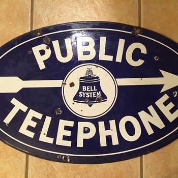 Oval Bell Systems sign - Advertising