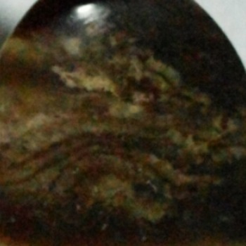 this is my best natural indonesian stone, something special about this liontin is there is a natural picture of dragon in it