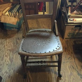 Wheeled antique chair